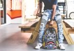 jeans uomo strappati foto
